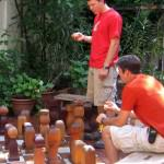 playing with our giant chess game in the garden