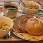 breakfast with fruits, bredrools, granola, cereals, coffee, tea, juice